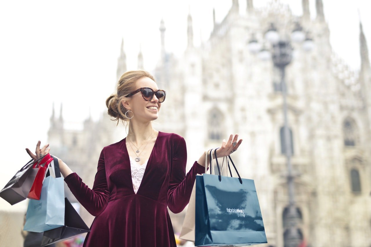 Girl shopper with bags of clothing